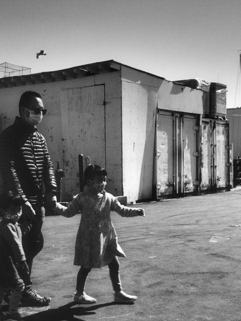 Family walking towards pier edge